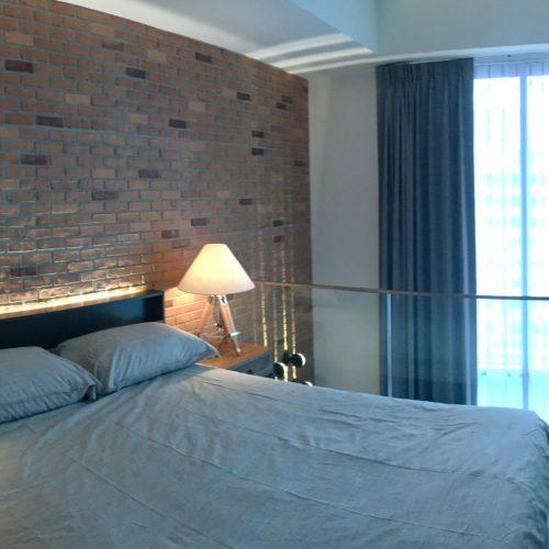 bricks wall bedroom and full height window