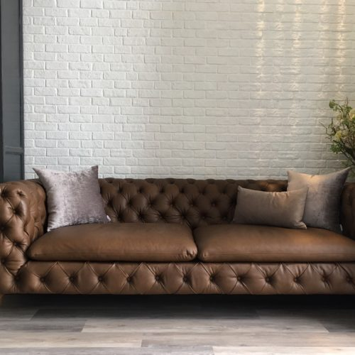 leather sofa with white bricks wall