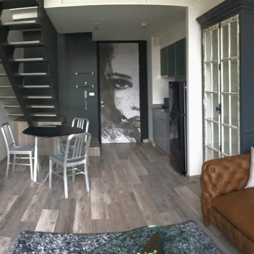 cotemporary loft Ekamai leather sofa white bricks