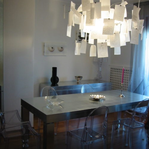 dining room with paper chandelier