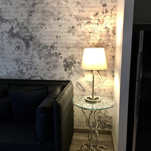 contemporary side table and grey wallpaper