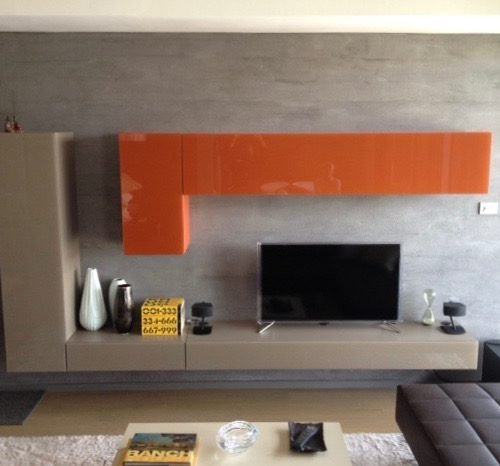 contemporary living room with orange cabinets