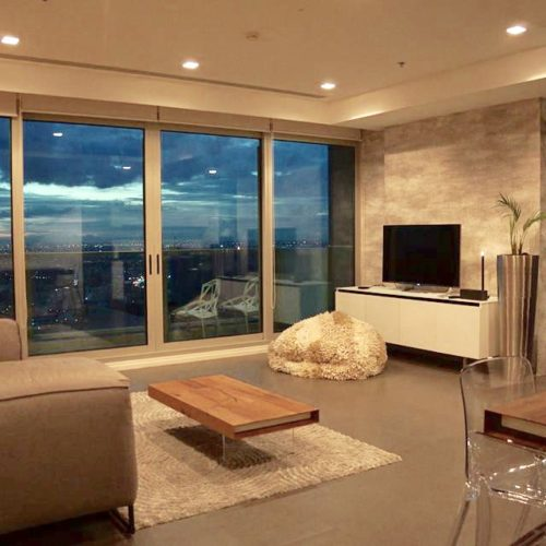 living room with full-height windows