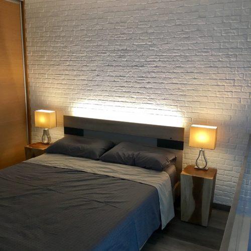 contemporary loft bedroom white bricks